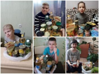 Дети с наборами продуктов к Новому году